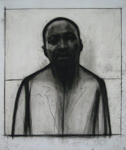 "John Wilson's ""Martin Luther King Jr."" etching is displayed in the ArtSpace as part of the ""30 Years of Printmaking"" Exhibit featuring artists affiliated with the Center Street Studio in Milton."
