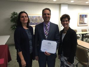 Jean McCann, Chair of the Member Services Committee and Stacey Bruzzese, President present the Business of the Month Award to Paul Magliochetti of SSJM Attorneys.