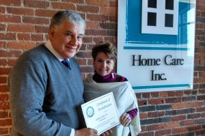 John Albert and Theresa Petrie show the certificate of accreditation for 2016
