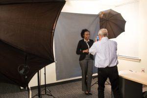 Jessica Castillo (NECC student) gets her LinkedIn portrait taken by Professor Lance Hidy
