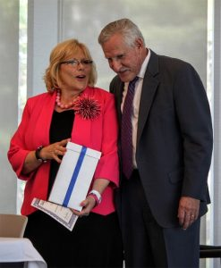 Massachusetts Commissioner of Higher Education, Carlos E. Santiago, presents Dianne McDermott Cerasuolo with an MCO Course of Distinction Award